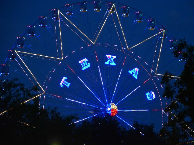 Ferris wheel lit up with letters spelling Texas
