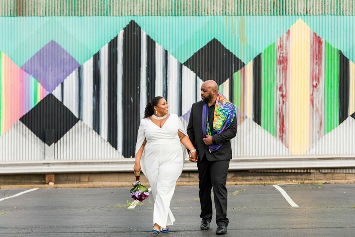 Modern Couple Wearing White Jumpsuit, Black Suit and Colorful Scarf