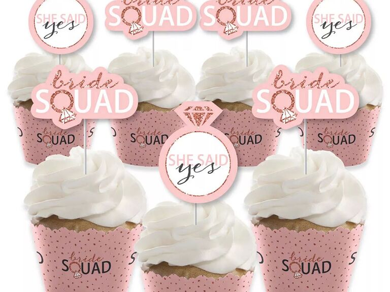 'Bride squad' in rose gold and white type with wedding ring detail and 'She said yes' inside wedding ring