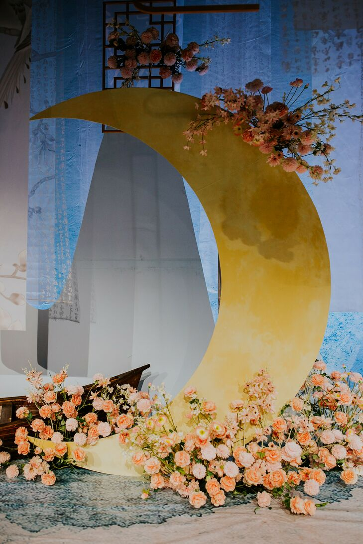 Moon-Shaped Backdrop With Flowers