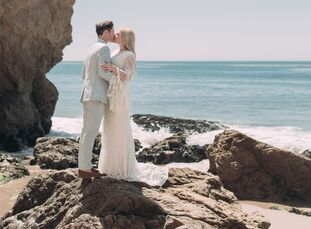 """DIY details and natural wood accents lent Lindsay Rahn and Sam Kattenhorn's bohemian beach wedding a hint of rustic flair. """"Growing up, we lived in Ve"""