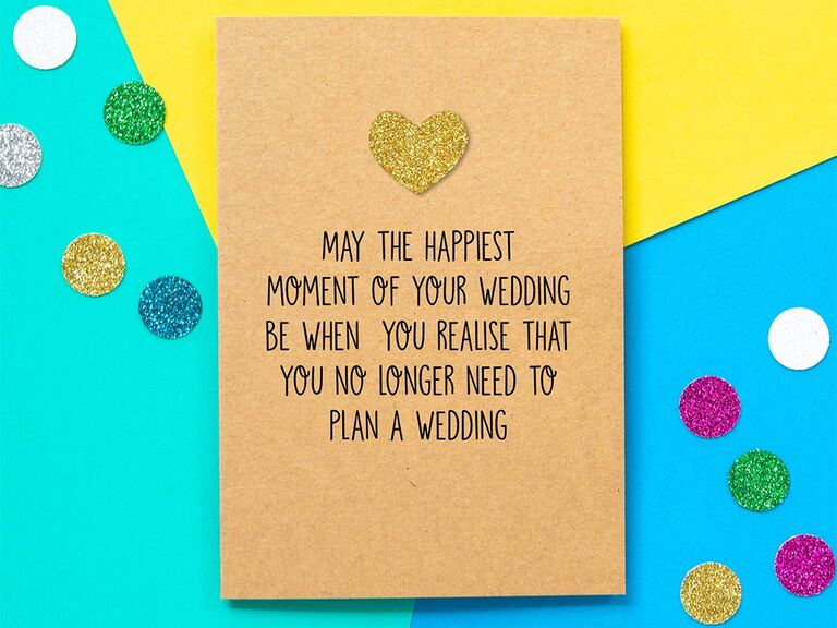 'May the happiest moment of your wedding be when you realize you no longer have to plan a wedding' in playful black type with gold glitter heart on kraft paper