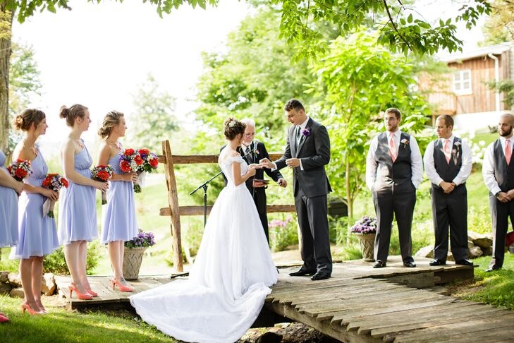 """""""My mom knew of the Highland Vue Farms owner through a church camp that we went to as kids. As soon as we saw the property, we knew we had to have our wedding there,"""" Kristie says. Their outdoor ceremony highlighted the natural landscape. The bridge served as their ceremony space while guests watched from rows of hay bales."""