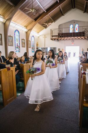 Elegant Flower Girls in White Dresses Carrying Bouquets