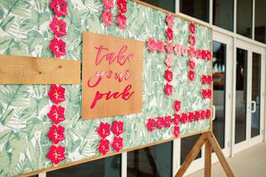 Escort Card Display With Hibiscus-Shaped Pink Acrylic Cards