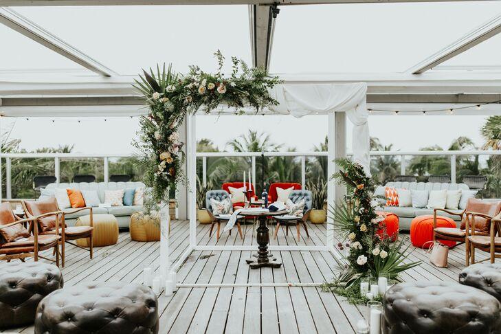 Modern Chuppah, Tropical Greenery and Lounge Furniture