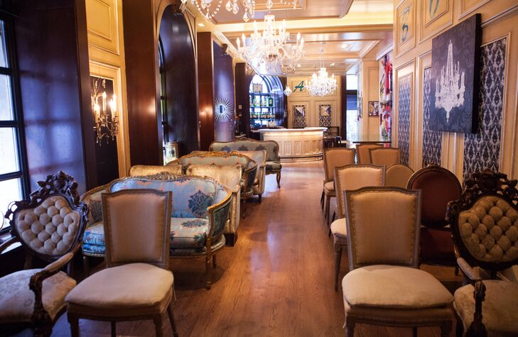 The ceremony was held in the bar area of the Millesime restaurant in the Carlton Hotel. The space already had an eclectic mix of sofas and chandeliers, so Gloria and Darren didn't need to add much in the way of decor.