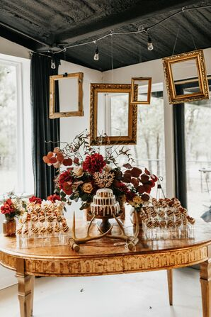 Picture Frames Hanging Over Dessert Table