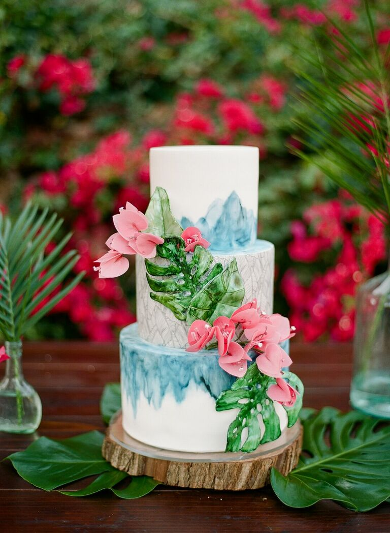 Tropical three-tier cake with painted decorations