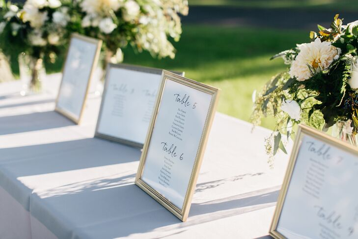 Table assignments were kept in spray-painted gold frames. The floral arrangements comrpised eucalyptus, rose, dahlia and greenery.