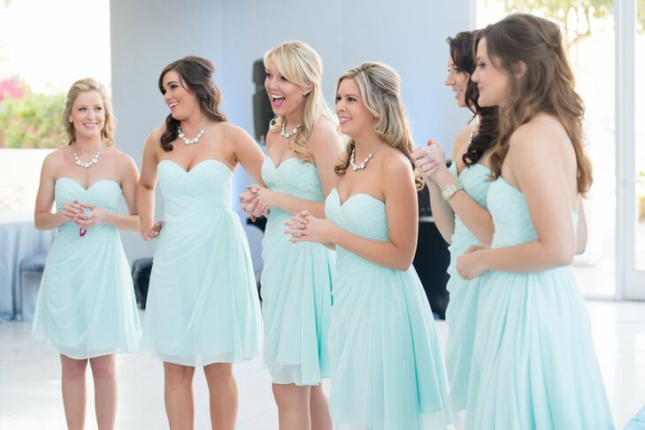 Brianna's bridesmaids wore light aqua strapless chiffon dresses with crystal statement necklaces for a light, chic look that matched the venue and wedding style.