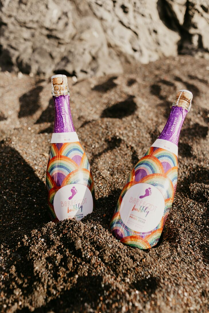 Rainbow-Hued Bottles of Champagne on the Beach