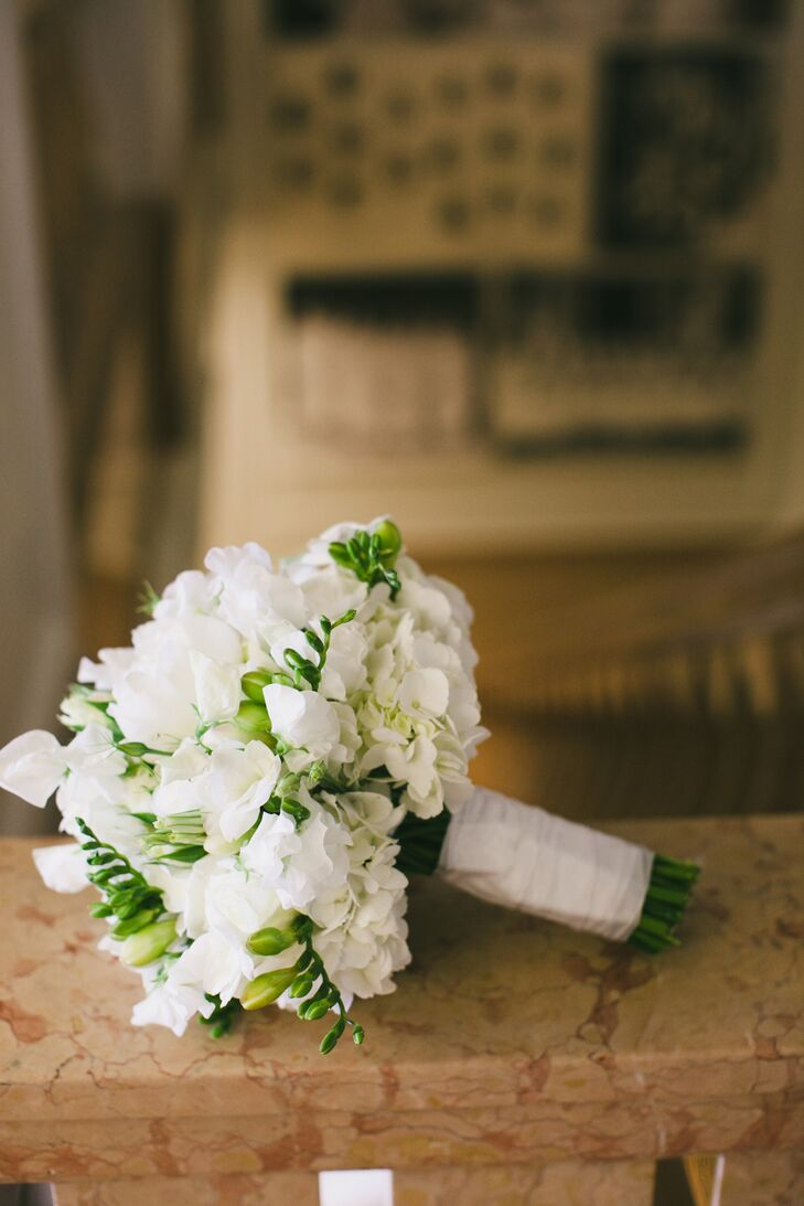 Cathy Cowman at The Bud Stop perfectly captured Margot's vision for simple, modern and fresh-from-the-garden florals in an all-white bouquet of sweet pea, peonies, hydrangeas, stock and roses.