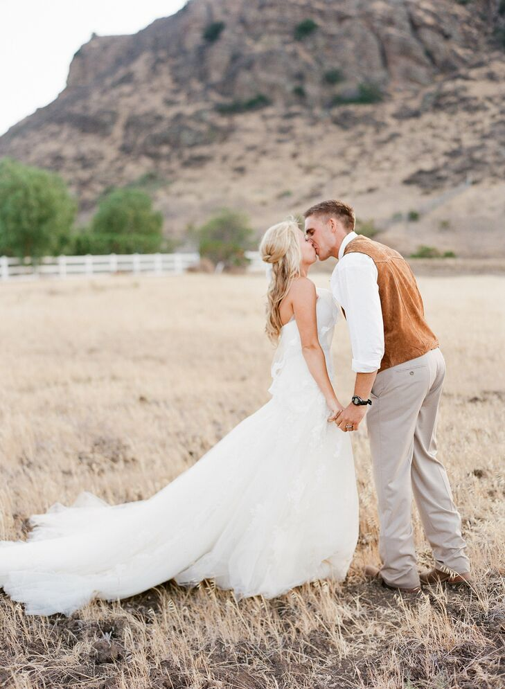 A soft pastel color palette, a custom designed antler motif and lots of natural wood and diy accents came together to give Jamie and Greggar's wedding