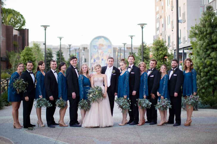 Alexandra's bridesmaids wore navy lace dresses with vintage-inspired bell sleeves, while Walter's groomsmen echoed his black tux and slip-ons.
