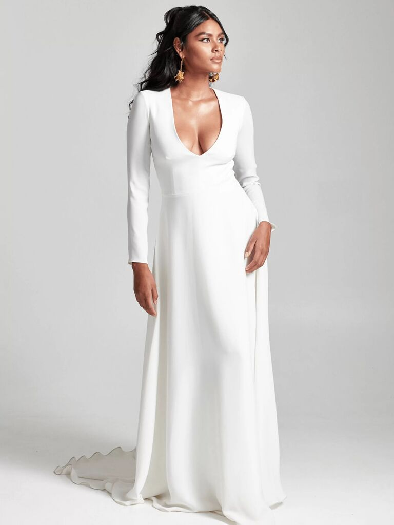 rebecca schoneveld white a line wedding dress with deep v-neckline long sleeves and flowy skirt