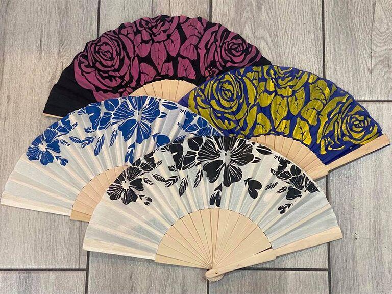Lace handheld fans with vintage floral design in pink, blue, gold and black