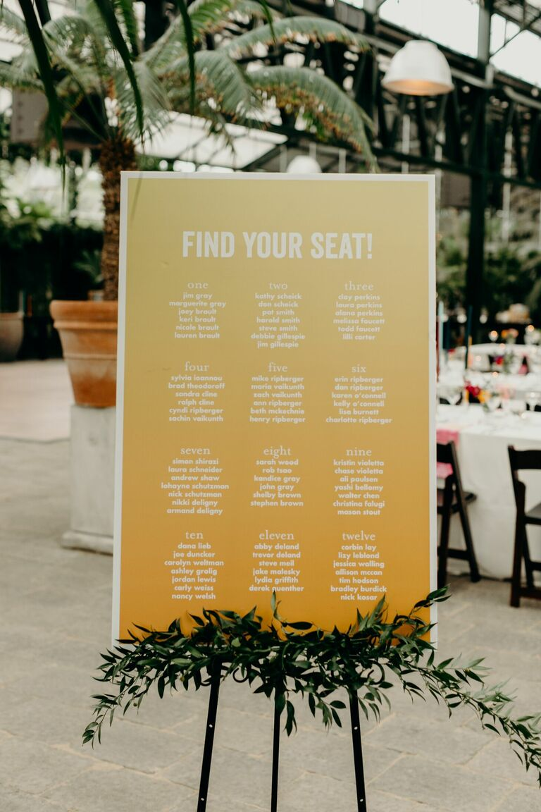 Simple yellow seating chart on easel