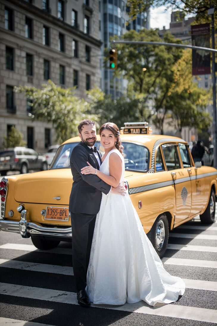 New York Couple Posing in Front of Yellow Taxicab on the Street