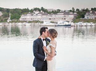 Bianca Moiseff (27 and a medical student) and Aaron Palushaj (26 and a professional hockey player) used an abundance of greenery and candlelight to ma