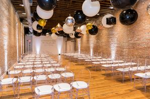 Indoor Ceremony Site with Brick Walls, Balloons and Ghost Chairs