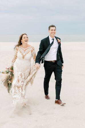 Bride and Groom Walk Along The Beach on Wedding Day