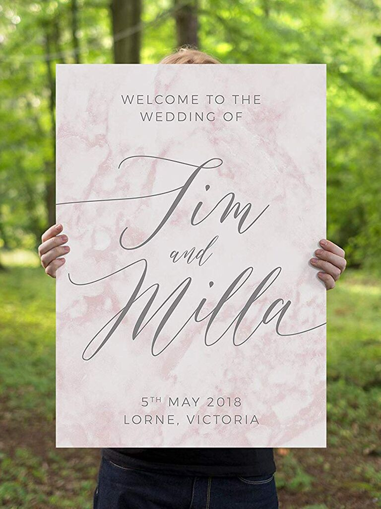 """Pink marble """"welcome to our wedding"""" sign"""