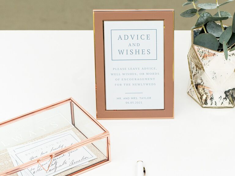 'Advice and wishes' in minimal blue type in bronze frame