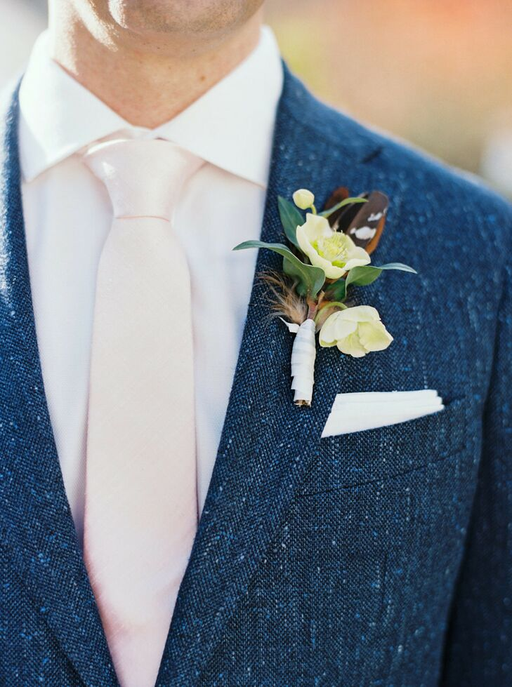Rustic Boutonniere with Hellebores and Pheasant Feathers