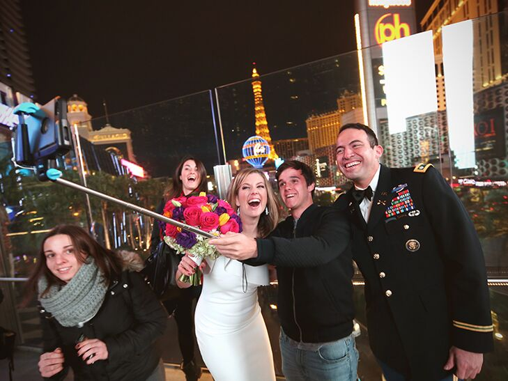 Brianna Keilar and Fernando Lujan pose for a selfie with Las Vegas tourists