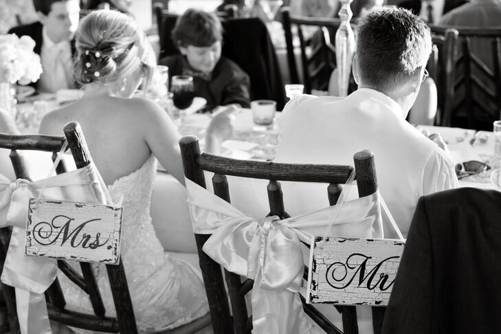 """The tables were two long tables parallel to each other for family style seating.""""Colin and I sat in the middle instead of a head table because we didn't want to be separated from our guests,"""" says Karen."""