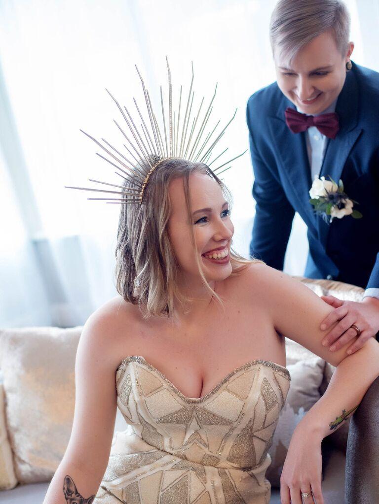 Bride wearing strapless wedding dress with celestial sunburst headpiece