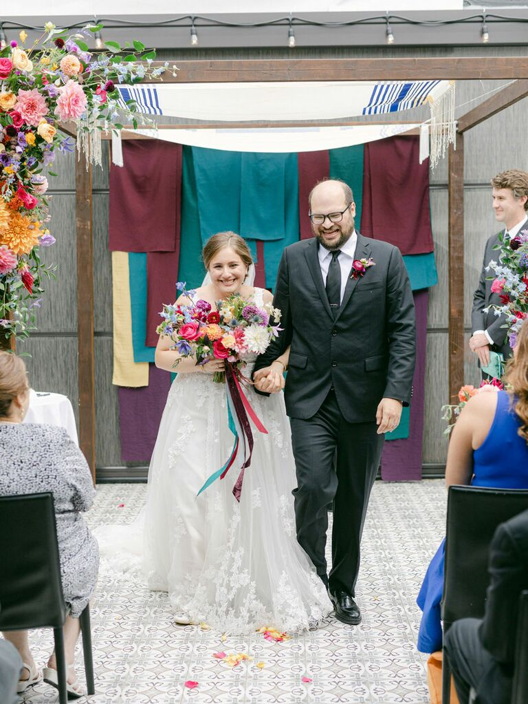 Bride and groom walking up the aisle during wedding recessional