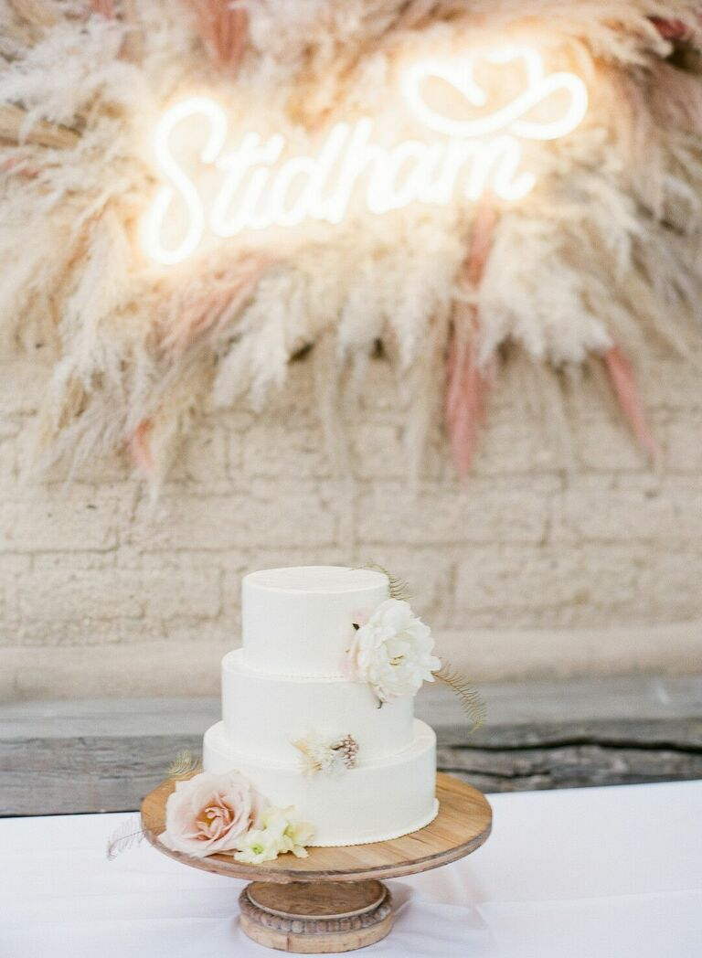 Three-tier cake with wood cake stand