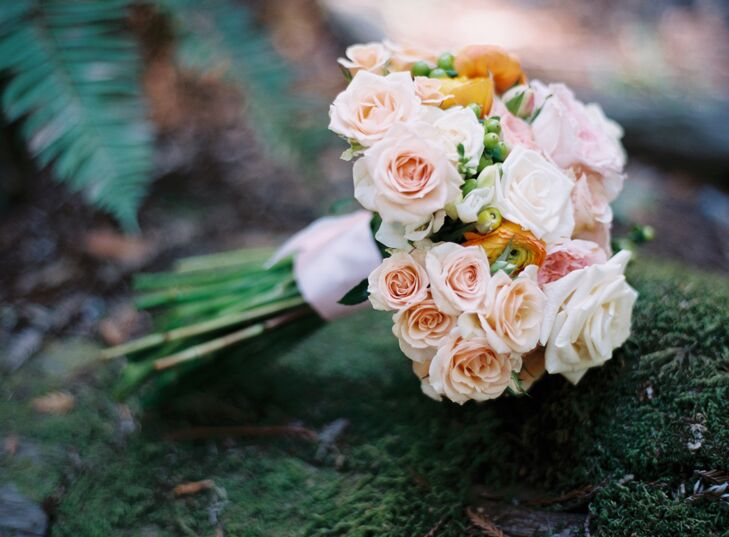 Liz made all the arrangements, including her own bridal bouquet, which was filled with pastel-colored roses and hypericum berries.