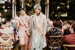 Grooms During Recessional at Glamorous Backyard Wedding Ceremony