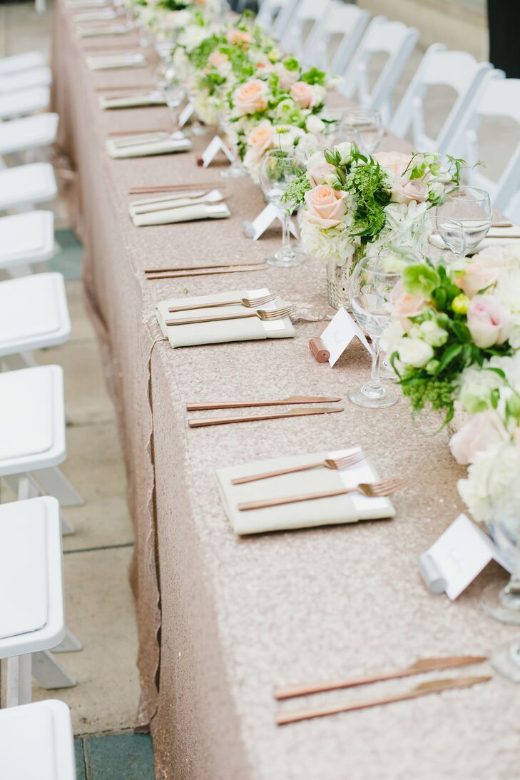 The head table was outfitted with textured rose gold linens and flowers set in vintage porcelain vases.
