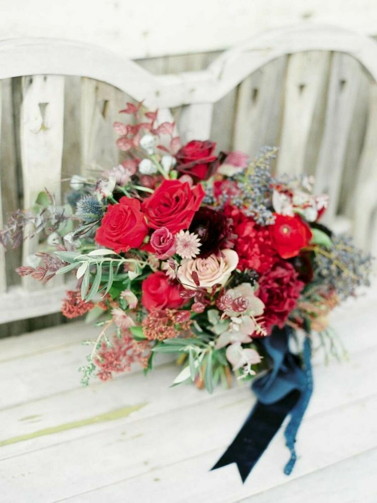 Wintry red rose bouquet with greenery