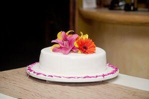 Single-Tier Wedding Cake With Bright Flowers