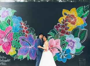 Winnie and Mark paid tribute to New York City's one-of-a-kind vibe with a bold jewel tone color palette and an edgy rustic-industrial venue. The festi