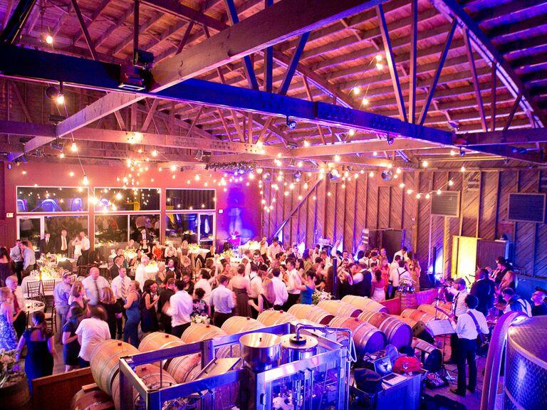 Rustic barn wedding venue with colored mood lighting