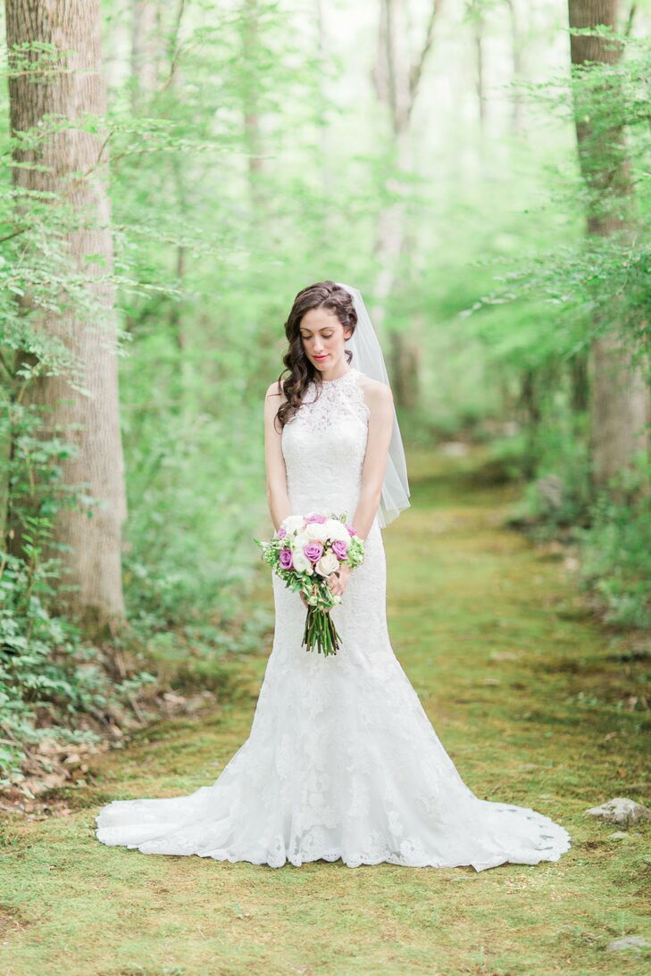 """After spotting a lace Kenneth Winston dress online, Tara tracked down the ivory, fit-and-flare lace gown. """"I knew I didn't want the typical sleeveless dress, so this was perfect,"""" she says of the design, which featured satin-covered buttons and a high neckline."""