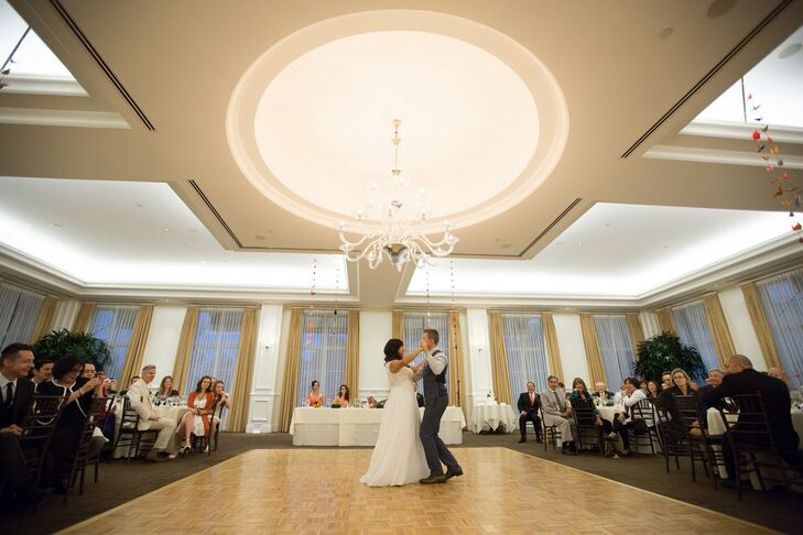 The married couple took their first dance in front of wedding guests on the dance floor.