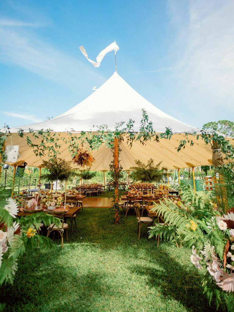 Cottagecore wedding venue reception tent with fresh floral arrangements