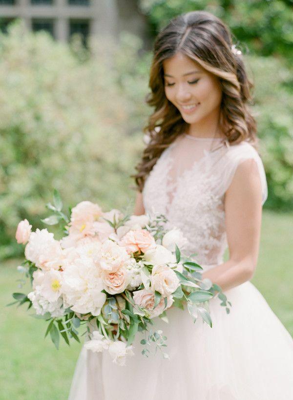 Bride holding romantic blush bouquet