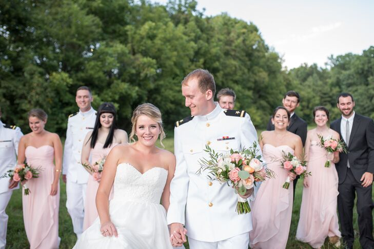 """Bridesmaids donned blush, floor-length gowns with a romantic sweetheart neckline from David's Bridal, while groomsmen wore a mix of white Navy uniforms and charcoal Kenneth Cole suits. """"We wanted the suits to be formal, matching the uniforms, but with subtle colors so the hypericum berry boutonnieres could pop,"""" Morgan says. """"I was worried about mixing the groomsmen and groom's attire, but the aesthetic in the end was perfect."""""""
