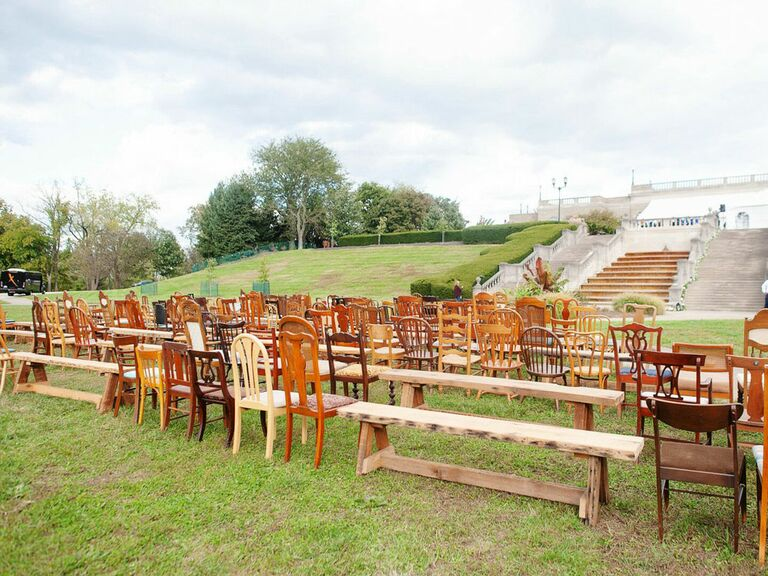 Mismatched antique wood chairs and benches for wedding ceremony seating