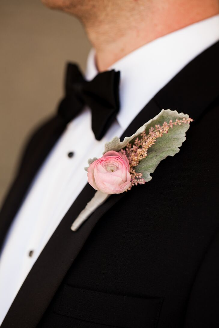 The groom and groomsmen wore black tuxedos with elegant single bloom ranunculus boutonnieres.rn