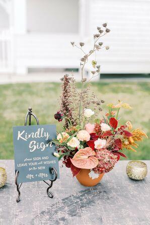 Guest Book Table With Bohemian Flower Arrangement