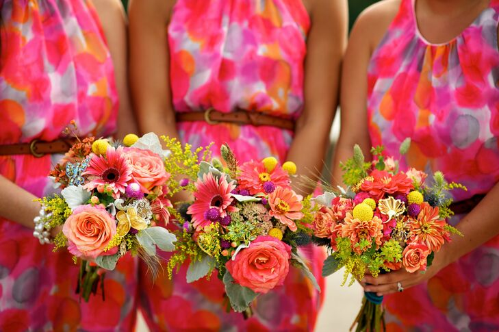 The bridesmaid bouquets were a vibrant mix of sunflowers, roses, daisies, billy balls and zinnias.